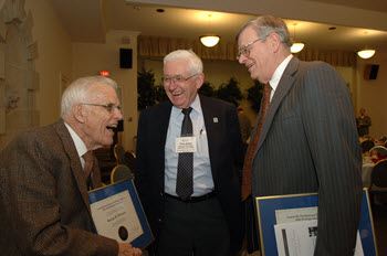 George Edwards, Tom Jones, and Bill McAtee celebrate after receiving their Distinguised Alum awards.