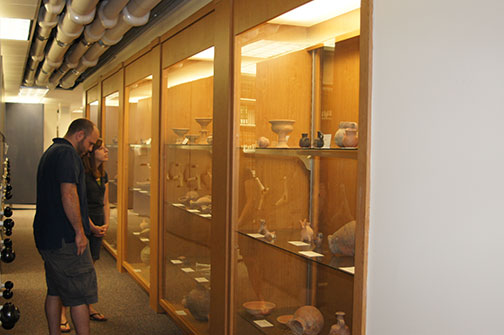 students viewing pottery collection
