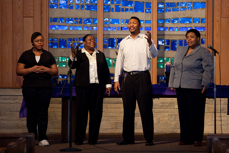 Students singing in the front of the chapel