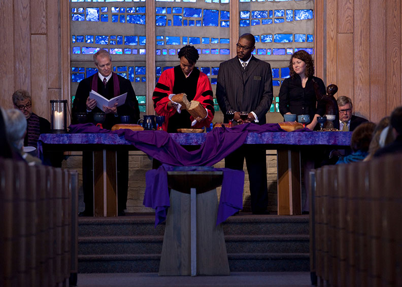 Ministers at the communion table